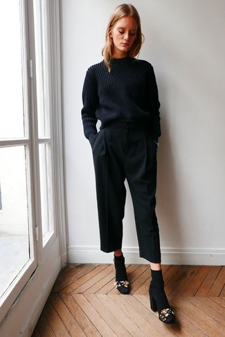 A black knit sweater and black culottes is a nice combo to add to your casual lineup. Dress up this look with black embellished suede heeled sandals.