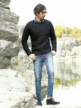 Men's Looks & Outfits: What To Wear In 2020: Pair a black cable sweater with blue skinny jeans for a casual kind of sophistication. To give this ensemble a more polished spin, why not add black leather derby shoes to the equation?