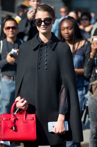 Dress in a Valentino Virgin Wool Cape and black skinny pants to achieve new levels in outfit coordination. This look is perfect for summer-to-fall weather.