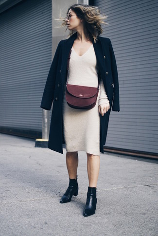 How to wear: black coat, beige sweater dress, black leather ankle boots, burgundy suede crossbody bag