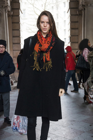 How to wear: black coat, black skinny jeans, orange print scarf