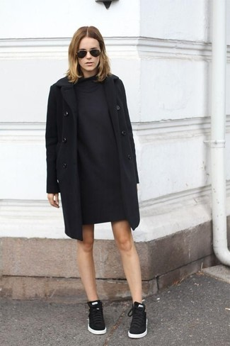 A sweater dress and a black sweater dress are both versatile essentials that will give your outfits a subtle modification. Black low top sneakers will give your look an on-trend feel.