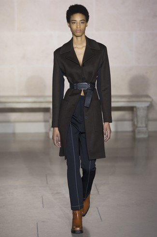 How to wear: black coat, navy skinny pants, brown leather ankle boots, black leather waist belt