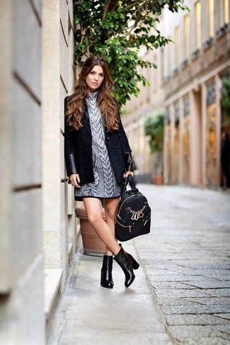 How to wear: black coat, silver sweater dress, black leather ankle boots, black leather backpack