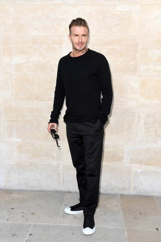 David Beckham wearing Black Crew-neck Sweater, Black Chinos, Black and White Low Top Sneakers