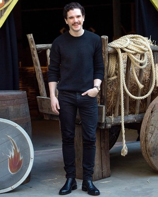 How to wear: black crew-neck sweater, black jeans, black leather chelsea boots, navy horizontal striped canvas watch