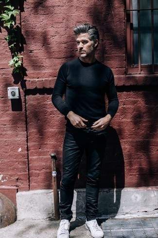 Men's Looks & Outfits: What To Wear In Spring: A black crew-neck sweater and black leather jeans are a savvy pairing worth having in your current styling routine. White low top sneakers are the glue that pulls this outfit together. If you're hunting for a comfortable transition getup, this just might be it.