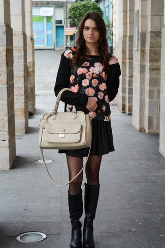 Black Leather Knee High Boots Casual Spring Outfits: Swing into something off-duty yet modern with a black floral crew-neck sweater and a black skater skirt. For extra fashion points, complete this outfit with a pair of black leather knee high boots. With springtime coming, it's time to make space for simple and beyond chic ensembles, just like this.
