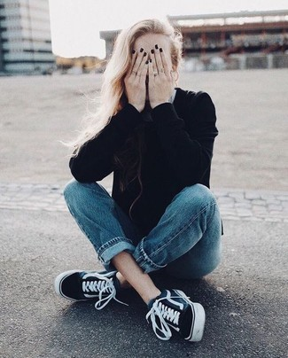 How to wear: black crew-neck sweater, blue jeans, black and white canvas low top sneakers