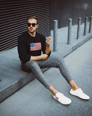 How to wear: black print crew-neck sweater, grey plaid chinos, white low top sneakers, black sunglasses