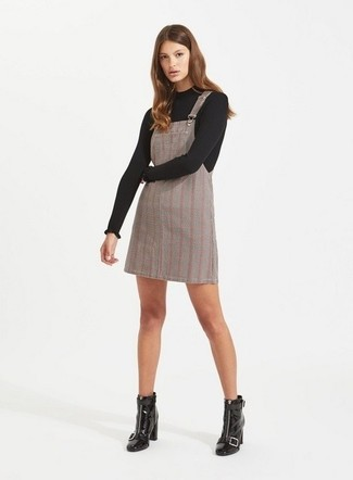 How to wear: black crew-neck sweater, grey plaid overall dress, black leather ankle boots
