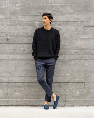Black Crew-neck Sweater Outfits For Men: For an ensemble that's pared-down but can be modified in a variety of different ways, wear a black crew-neck sweater and navy chinos. Add a pair of navy canvas driving shoes to the mix to tie your full outfit together.