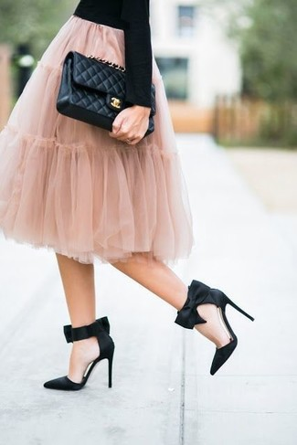 How to wear: black crew-neck sweater, pink tulle full skirt, black satin pumps, black quilted leather crossbody bag