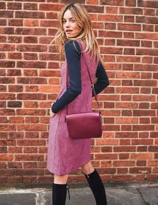 How to Wear a Purple Crossbody Bag: Putting together a black crew-neck sweater with a purple crossbody bag is a wonderful choice for an off-duty but totaly chic look. Want to go all out in the shoe department? Add black suede knee high boots to the mix.