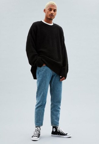 How to Wear Light Blue Jeans For Men: Consider teaming a black crew-neck sweater with light blue jeans to pull together an everyday getup that's full of charm and character. Go off the beaten path and switch up your ensemble by slipping into a pair of black and white canvas high top sneakers.