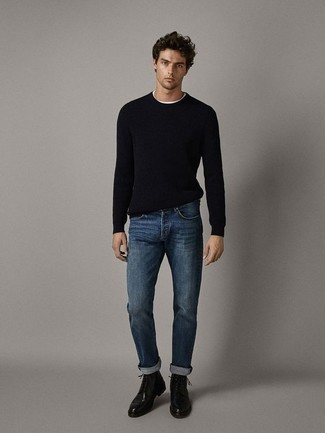 Black Crew-neck Sweater Outfits For Men: If the situation allows relaxed dressing, pair a black crew-neck sweater with navy jeans. Take your ensemble in a more sophisticated direction with a pair of black leather casual boots.