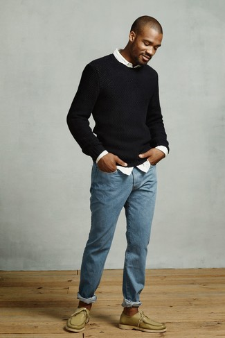 How to Wear Boat Shoes In Your 20s: This relaxed casual combo of a black crew-neck sweater and blue jeans is a solid bet when you need to look sharp in a flash. A pair of boat shoes will pull the whole thing together.