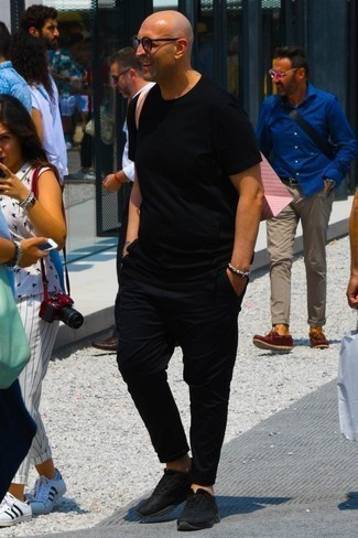 How to Wear Black Athletic Shoes For Men: You'll be surprised at how easy it is for any guy to get dressed like this. Just a black crew-neck t-shirt and black chinos. For something more on the daring side to round off your look, complement your outfit with a pair of black athletic shoes.