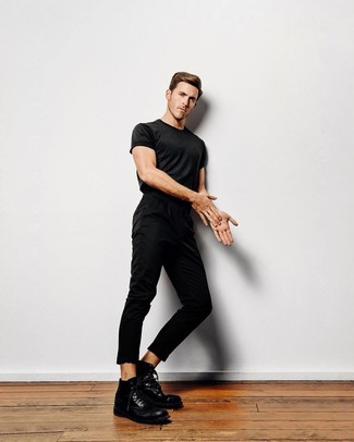 How to wear: black crew-neck t-shirt, black chinos, black leather casual boots