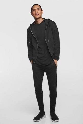 Black Track Suit Outfits For Men: Team a black track suit with a black crew-neck t-shirt for an easy-to-achieve ensemble. On the shoe front, this getup is completed perfectly with black and white athletic shoes.