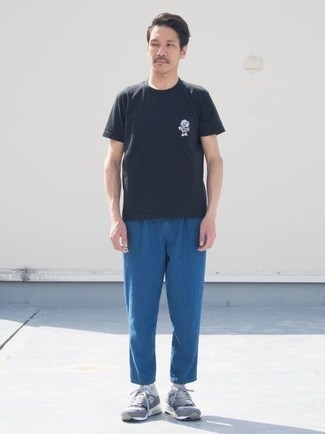 How to Wear a Black Print Crew-neck T-shirt For Men: Dress in a black print crew-neck t-shirt and blue jeans for a casual level of dress. Grey athletic shoes can immediately tone down a smart outfit.
