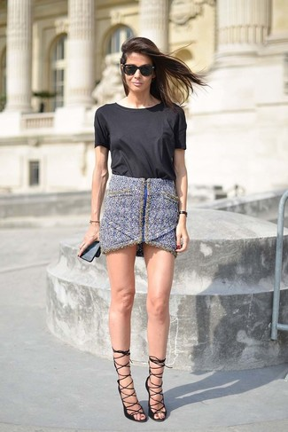 How to wear: black crew-neck t-shirt, blue tweed mini skirt, black leather heeled sandals, black sunglasses