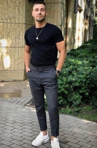 How to Wear a Leather Watch For Men: If you're looking for a laid-back yet seriously stylish look, reach for a black crew-neck t-shirt and a leather watch. For something more on the dressier side to complete your ensemble, complete this ensemble with white athletic shoes.