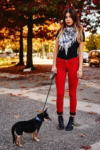How to wear: black crew-neck t-shirt, red skinny jeans, black embellished leather ankle boots, white star print scarf