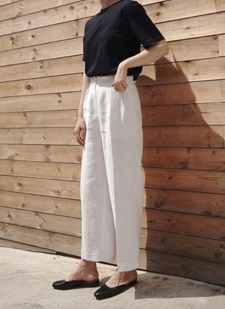 A black crew-neck tee and white linen wide leg pants feel perfectly suited for weekend activities of all kinds. Ballerina flats will give your look an on-trend feel.