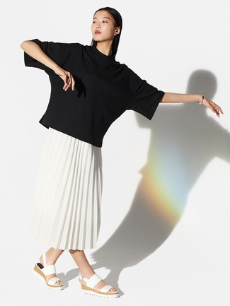 How to wear: black crew-neck t-shirt, white pleated midi skirt, white leather flat sandals