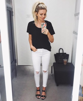 How to wear: black crew-neck t-shirt, white ripped skinny jeans, black leather flat sandals