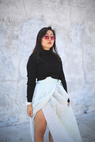 Stay stylish on busy days in a black cropped sweater and a white eyelet maxi skirt.