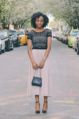 A nicely put together combination of a black lace cropped top and a beige pleated midi skirt will set you apart effortlessly. Clear suede pumps will add elegance to an otherwise simple look.