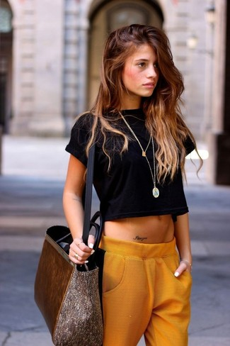 Rock a black cropped top with orange pajama pants for an easy to wear look.