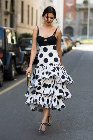 Look stylish yet practical in a black cropped top and a white and black polka dot midi skirt. Elevate this ensemble with black and white polka dot leather pumps. If you're trying to figure out a summer-ready getup, here is a great one.