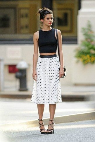 How to wear: black cropped top, white and black polka dot midi skirt, black leather gladiator sandals, black leather crossbody bag