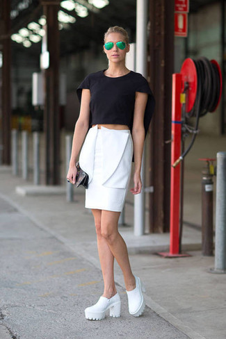 A black cropped top with a white pencil skirt has become an essential combination for many style-conscious girls. A cool pair of white leather ankle boots is an easy way to upgrade your look.