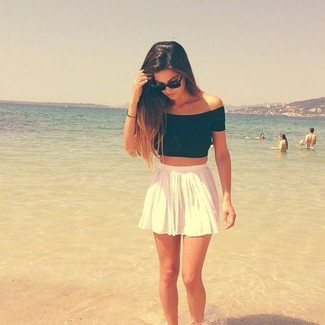 Consider pairing a black cropped top with a white skater skirt for a trendy and easy going look.