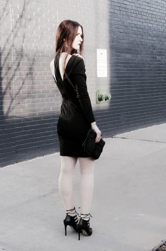 How to wear: black cutout bodycon dress, black cutout leather pumps, black fur clutch