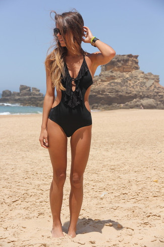 How to wear: black cutout swimsuit, black sunglasses, black leather bracelet