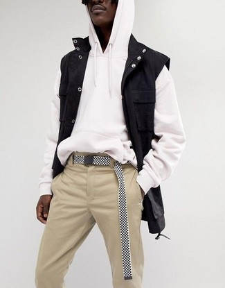 How to wear: black denim gilet, white hoodie, beige chinos, black and white canvas belt