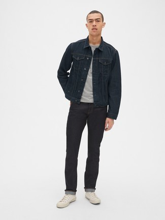Denim Jacket Outfits For Men: A denim jacket and black jeans will convey this casually dapper vibe. Exhibit your fun side by finishing off with a pair of white canvas high top sneakers.