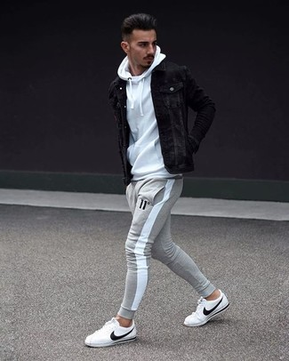 How to wear: black denim jacket, white hoodie, grey sweatpants, white leather low top sneakers
