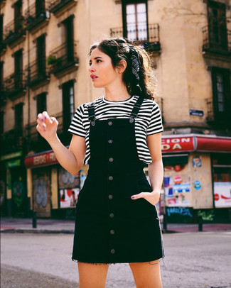 How to wear: black denim overall dress, white and black horizontal striped crew-neck t-shirt