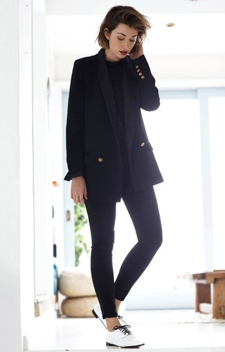 How to wear: black double breasted blazer, black long sleeve blouse, black skinny jeans, white leather oxford shoes