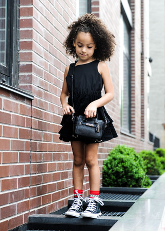 How to wear: black dress, black sneakers, black bag, red socks