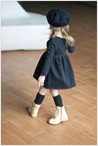 How to wear: black dress, tan boots, black beret, black socks