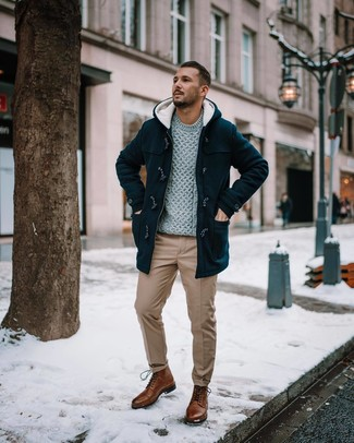 How to Wear a Black Duffle Coat For Men: Choose a black duffle coat and khaki chinos to exude manly refinement and polish. A pair of brown leather casual boots finishes this ensemble very nicely.