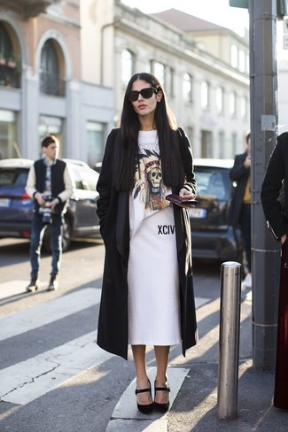 How to Wear a White Pencil Skirt: Wear a black duster coat with a white pencil skirt for a comfortable ensemble that's also well-executed. A pair of black suede pumps acts as the glue that brings this outfit together.