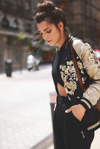 Black Embroidered Bomber Jacket Outfits For Women: This pairing of a black embroidered bomber jacket and black tapered pants combines comfort and fashion.
